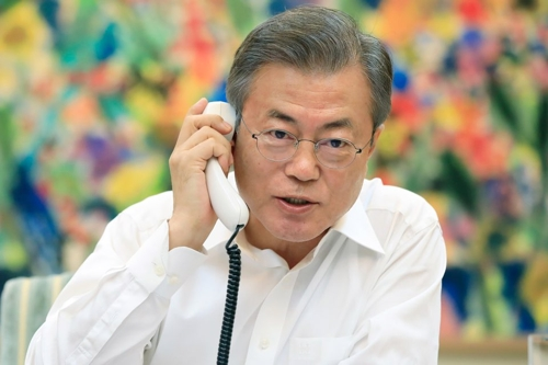 In this photo provided by South Korea's presidential office Cheong Wa Dae, South Korean President Moon Jae-in holds a telephone conversation with U.S. President Donald Trump on Sept. 4, 2018. (Yonhap)