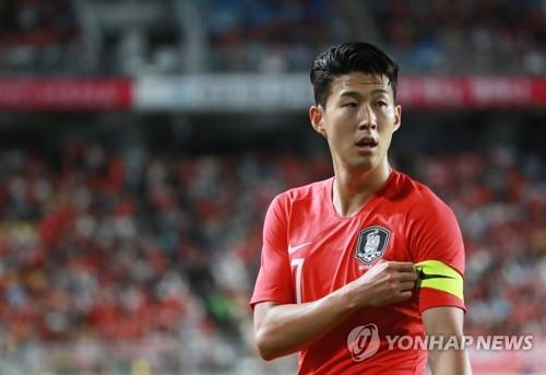 South Korea's Son Heung-min grabs his captain's armband during a friendly football match at Suwon World Cup Stadium in Suwon, south of Seoul, on Sept. 11, 2018.