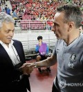 Chile national football team head coach Reinaldo Rueda (L) shakes hands with South Korea head coach Paulo Bento before the kickoff of a friendly football match between their teams at Suwon World Cup Stadium in Suwon, south of Seoul, on Sept. 11, 2018. (Yonhap)