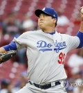 In this Associated Press photo, Ryu Hyun-jin of the Los Angeles Dodgers throws a pitch against the Cincinnati Reds in the bottom of the first inning of a Major League Baseball regular season game at Great American Ball Park in Cincinnati on Sept. 11, 2018. (Yonhap)