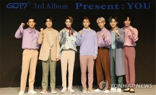 """GOT7 members pose for photos during a press conference announcing the release of their new album """"Present:YOU"""" on Sept. 17, 2018. (Yonhap)"""