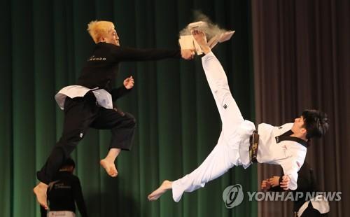 In this file photo, taken April 2, 2018, South Korean taekwondo practitioners perform at Pyongyang Grand Theatre in Pyongyang. (Yonhap)