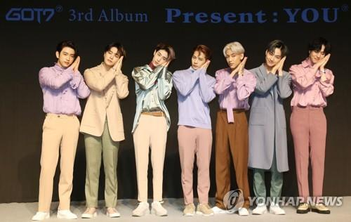 The seven GOT7 members pose for photos during a press conference on Sept. 17, 2018. (Yonhap)