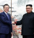South Korean President Moon Jae-in (L) and North Korean leader Kim Jong-un shake hands after holding a joint press conference in Pyongyang on Sept. 19, 2018, to announce the outcome of their bilateral summit that began the previous day. (Joint Press Corps-Yonhap)
