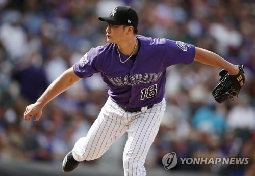 In this Associated Press photo, Oh Seung-hwan of the Colorado Rockies throws a pitch against the Philadelphia Phillies in the top of the seventh inning of a Major League Baseball regular season game at Coors Field in Denver on Sept. 27, 2018. (Yonhap)