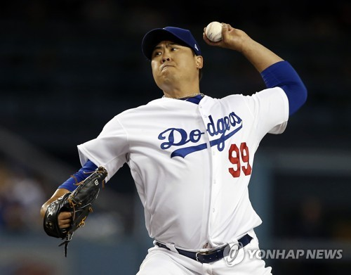 In this Associated Press photo, Los Angeles Dodgers starting pitcher Ryu Hyun-jin throws a pitch against the Colorado Rockies during the top of the first inning of a Major League Baseball regular season game at Dodger Stadium in Los Angeles on Sept. 17, 2018. (Yonhap)