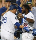 In this Reuters photo via USA Today Sports, Ryu Hyun-jin of the Los Angeles Dodgers (L) is congratulated by teammate Yasiel Puig after scoring on a two-run homer by Joc Pederson against the Colorado Rockies in the bottom of the fourth inning of a Major League Baseball regular season game at Dodger Stadium in Los Angeles on Sept. 17, 2018. (Yonhap)