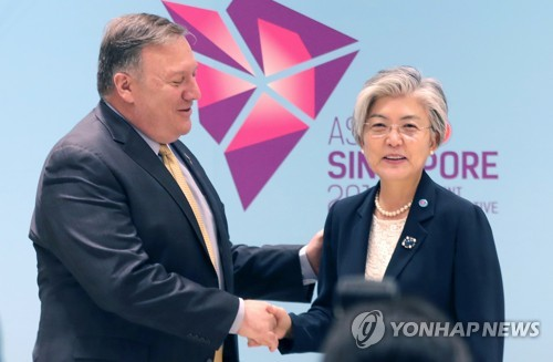 This file photo shows South Korean Foreign Minister Kang Kyung-wha (R) with U.S. Secretary of State Mike Pompeo. (Yonhap)