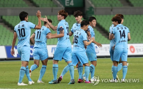 This file photo, taken Aug. 8, 2018, shows Daegu FC players celebrating after scoring a goal against Yangpyeong FC in their Korea Football Association Cup round of 16 match at Daegu Stadium in Daegu. (Yonhap)