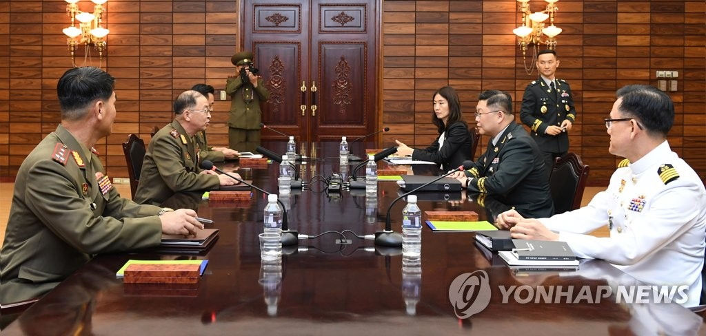South Korean (L) and North Korean officials hold working-level military talks at the truce village of Panmunjom on Sept. 13, 2018, in this photo provided by Seoul's defense ministry. (Yonhap)
