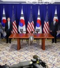 South Korean President Moon Jae-in (third from L, at podium) and U.S. President Donald Trump (second from R, at podium) hold a joint press conference before signing a joint statement welcoming the conclusion of negotiations to revise the South Korea-U.S. free trade agreement in New York on Sept. 24, 2018. (Yonhap)
