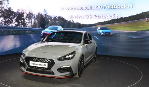 This undated photo provided by Hyundai Motor shows the carmaker's high-performance model i30 Fastback N displayed at the 2018 Paris Motor Show. (Yonhap)