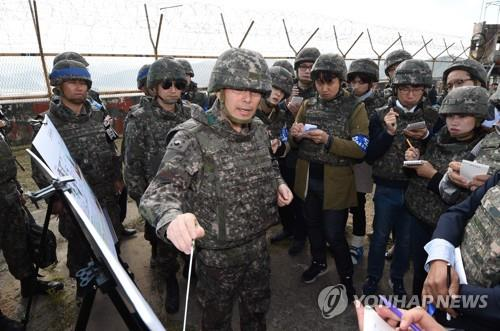 An Army official briefs reporters on demining operations inside the Demilitarized Zone on Oct. 2, 2018, in this photo provided by the Joint Press Corps. (Yonhap)