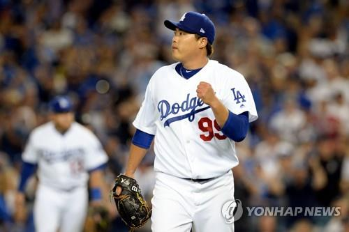 In this Reuters photo from USA Today Sports, Ryu Hyun-jin of the Los Angeles Dodgers pumps his fist after striking out Ozzie Albies to end the top of the seventh inning in Game 1 of the National League Division Series at Dodger Stadium in Los Angeles on Oct. 4, 2018. (Yonhap)