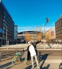 This image captured from BTS's official Twitter account on Oct. 16, 2018, shows a masked band member posing in front of the Mercedes-Benz Arena in Berlin, Germany. (Yonhap)