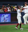 Jerry Sands of the Nexen Heroes (R) celebrates his two-run home run with teammate Seo Geon-chang in the bottom of the seventh inning of the Korea Baseball Organization wild card game against the Kia Tigers at Gocheok Sky Dome in Seoul on Oct. 16, 2018. (Yonhap)