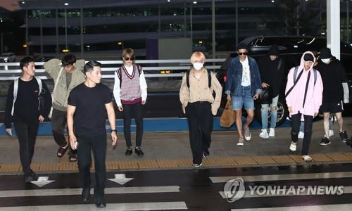 """Members of boy group BTS arrive at Incheon International Airport, west of Seoul, on Sept. 3, 2018, to head to Los Angeles, the group's first stop of its world tour. BTS reached No. 1 on the Billboard 200 Albums chart for the second time a day before with its latest album """"Love Yourself: Answer."""" (Yonhap)"""