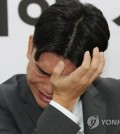 Lee Seok-cheol, the 18-year-old leader of teenage K-pop band The East Light, wipes his eyes during a press conference on Oct. 19, 2018. (Yonhap)