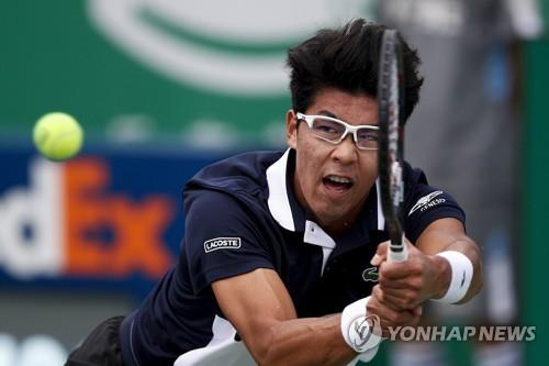In this Associated Press file photo from Oct. 10, 2018, Chung Hyeon of South Korea hits a return shot to Marco Cecchinato of Italy during their men's singles match in the Shanghai Masters tennis tournament at Qizhong Forest Sports City Tennis Center in Shanghai. (Yonhap)