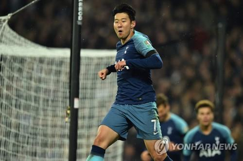 This photo taken by the AFP shows Tottenham Hotspur's South Korean forward Son Heung-Min celebrating his goal during the English League Cup football match between West Ham United and Tottenham Hotspur at London Stadium in east London on Oct. 31, 2018. (Yonhap)