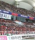 This file photo taken on Sept. 7, 2018, shows South Korean fans watching a friendly football match between South Korea and Costa Rica at Goyang Stadium in Goyang, north of Seoul. (Yonhap)