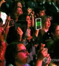 BTS fans cheer as the K-pop boy band takes the stage during a South Korea-France friendship concert in Paris on Oct. 14, 2018. (Yonhap)