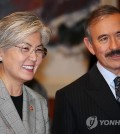 South Korean Foreign Minister Kang Kyung-wha (L) and U.S. Ambassador to Seoul Harry Harris attend a ceremony to sign a deal on renewing the WEST program in Seoul on Oct. 22, 2018. (Yonhap)