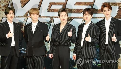 "EXO members pose for photos during a press conference on Nov. 1, 2018 to announce the release of their new album ""Don't Mess Up My Tempo."" (Yonhap)"
