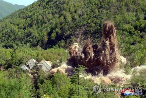 This photo, provided by North Korea's state news agency on May 25, 2018, shows North Korea's demolition of its Punggye-ri nuclear test site on the northeast. (For Use Only in the Republic of Korea No Redistribution) (Yonhap)