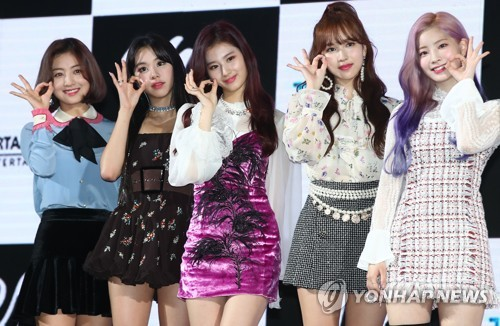 "Members of TWICE pose for photos during a media showcase for the group's sixth EP, ""Yes or Yes,"" at KBS Arena in western Seoul on Nov. 5, 2018. (Yonhap)"