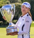 Jin Young Ko of South Korea kisses the trophy after winning the CP Women's Open in Aurora, Ontario, Sunday, Aug. 25, 2019. (Frank Gunn/The Canadian Press via AP)