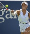 Kristie Ahn, of the United States, returns a shot to Jelena Ostapenko, of Latvia, during round three of the US Open tennis championships Saturday, Aug. 31, 2019, in New York. (AP Photo/Michael Owens)
