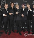 Ten, from left, Baekhyun, Lucas, Taemin, Taeyong, Kai and Mark, of SuperM, attend a media conference on Thursday, Oct. 3, 2019, at Capitol Studios in Los Angeles. (AP)