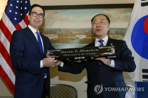 Secretary of the Treasury Steven Mnuchin receives a gift from South Korean Deputy Prime Minister and Finance Minister Hong Nam-ki after a signing ceremony of U.S.- Republic of Korea Framework to Strengthen Infrastructure Finance and Market Building Cooperation, at Treasury Department in Washington, Thursday, Oct. 17, 2019. [AP]