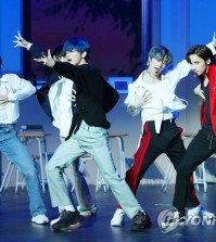 "K-pop rookie band Tomorrow X Together, also known as TXT, performs during a showcase for its first full-length album, ""The Dream Chapter: Magic,"" in Seoul on Oct. 21, 2019. (Yonhap)"